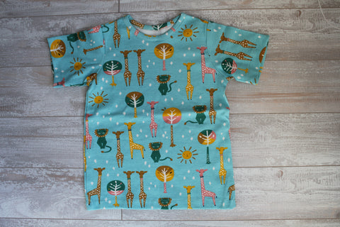 Colorful Giraffes on Green T-Shirt