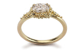 1. Cluster Ring - 18ct yellow gold and oval diamond