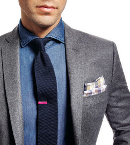 styled outfit with a blazer, tie, and tie bar