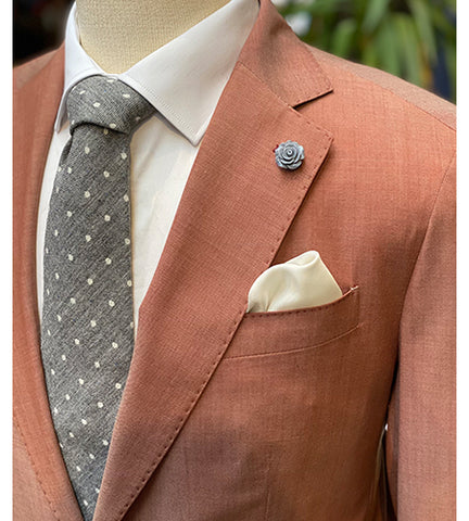 coral suit with grey accessories