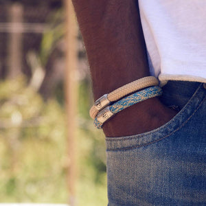two rope bracelets on the model. Beige and light blue rope bracelets for men with magnetic clasp.