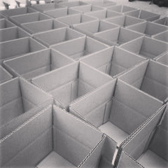 TriRoCo prepping boxes for coffee gift shipping