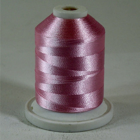 An Light Pink colored 1100 yd mini king spool of Robison-Anton 40wt Rayon that is vivid, high luster and super-smooth in appearance.