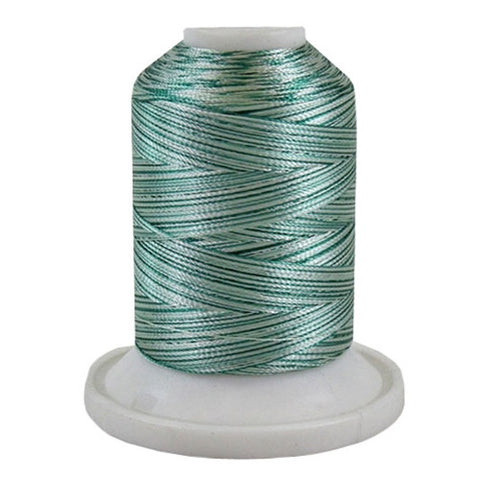 A 3CC Green variegated 700 yd mini king spool of Robison-Anton 40wt Rayon that is vivid, high luster and super-smooth in appearance.
