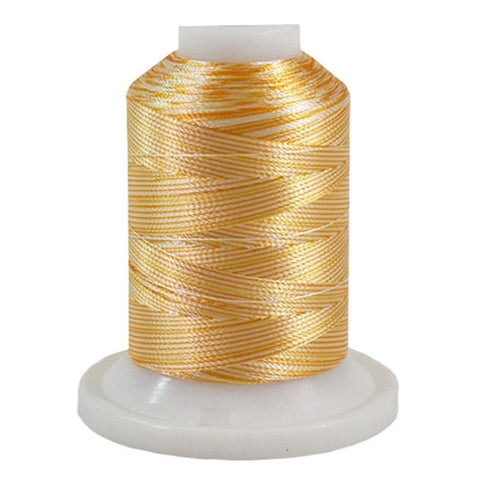 A 3CC Yellow variegated 700 yd mini king spool of Robison-Anton 40wt Rayon that is vivid, high luster and super-smooth in appearance.