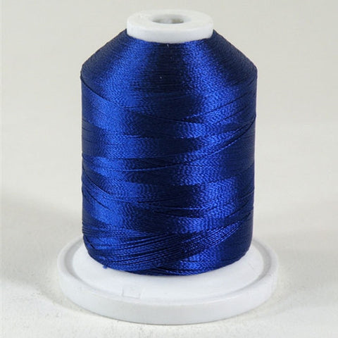 A Jamie Blue colored 1100 yd mini king spool of Robison-Anton 40wt Rayon that is vivid, high luster and super-smooth in appearance.