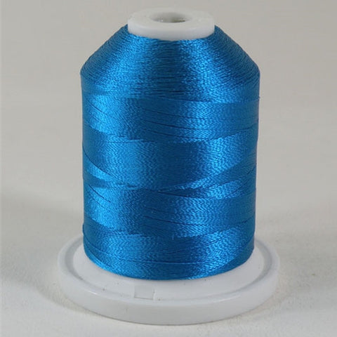 A Pacific Blue colored 1100 yd mini king spool of Robison-Anton 40wt Rayon that is vivid, high luster and super-smooth in appearance.