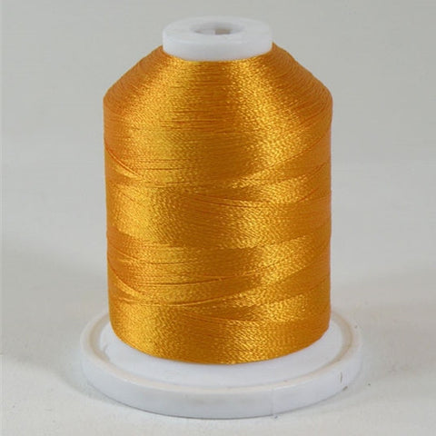 A Mango orange colored 1100 yd mini king spool of Robison-Anton 40wt Rayon that is vivid, high luster and super-smooth in appearance.