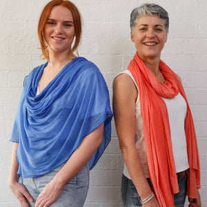 Poppy with cornflower blue wrap and Jill in burnt orange wrap