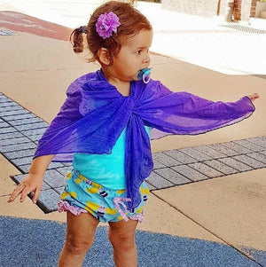 toddler with purple scarf as wrap