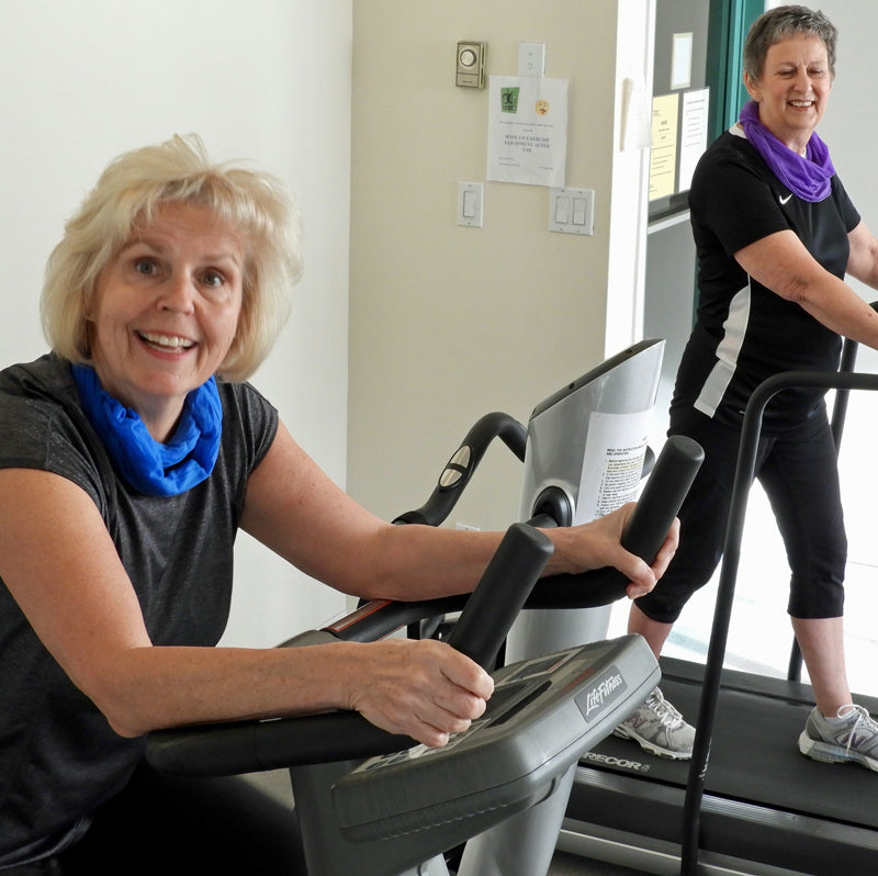 2 women on cardio equipment