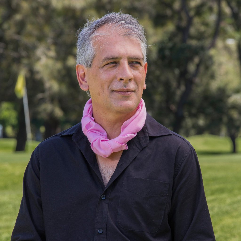 male in cherry blossom pink neck scarf on golf course