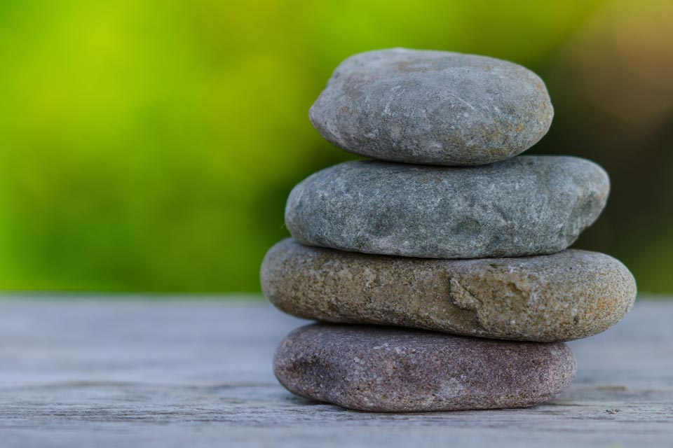 Rocks stacked on top of one another in a reaching zen exercise