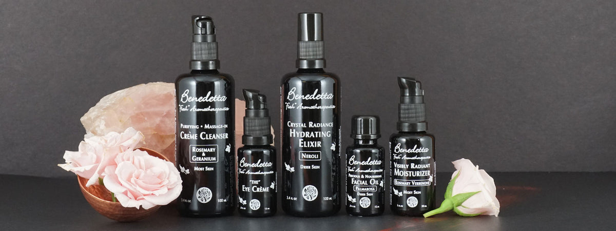 Art shot of our 5 step facial regimen with pink roses