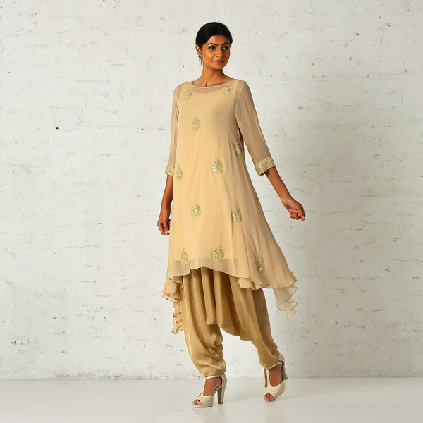 Beige asymmetrical tunic with a dhoti salwaar