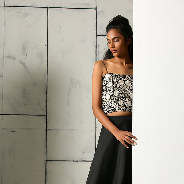 Embroidered crop top with a black skirt