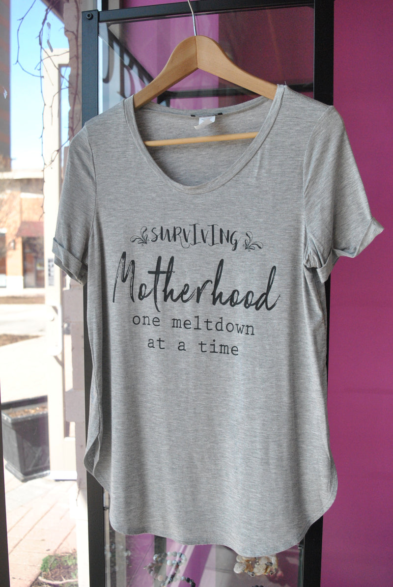 "T-SHIRT - ""SURVIVING MOTHERHOOD ONE MELTDOWN AT A TIME "" - GREY"