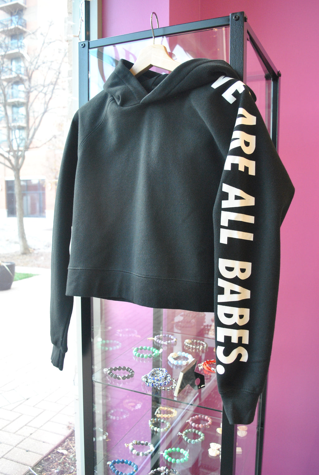 "BLACK SWEATSHIRT ""WE ARE ALL BABES"" WITH A HOODIE"