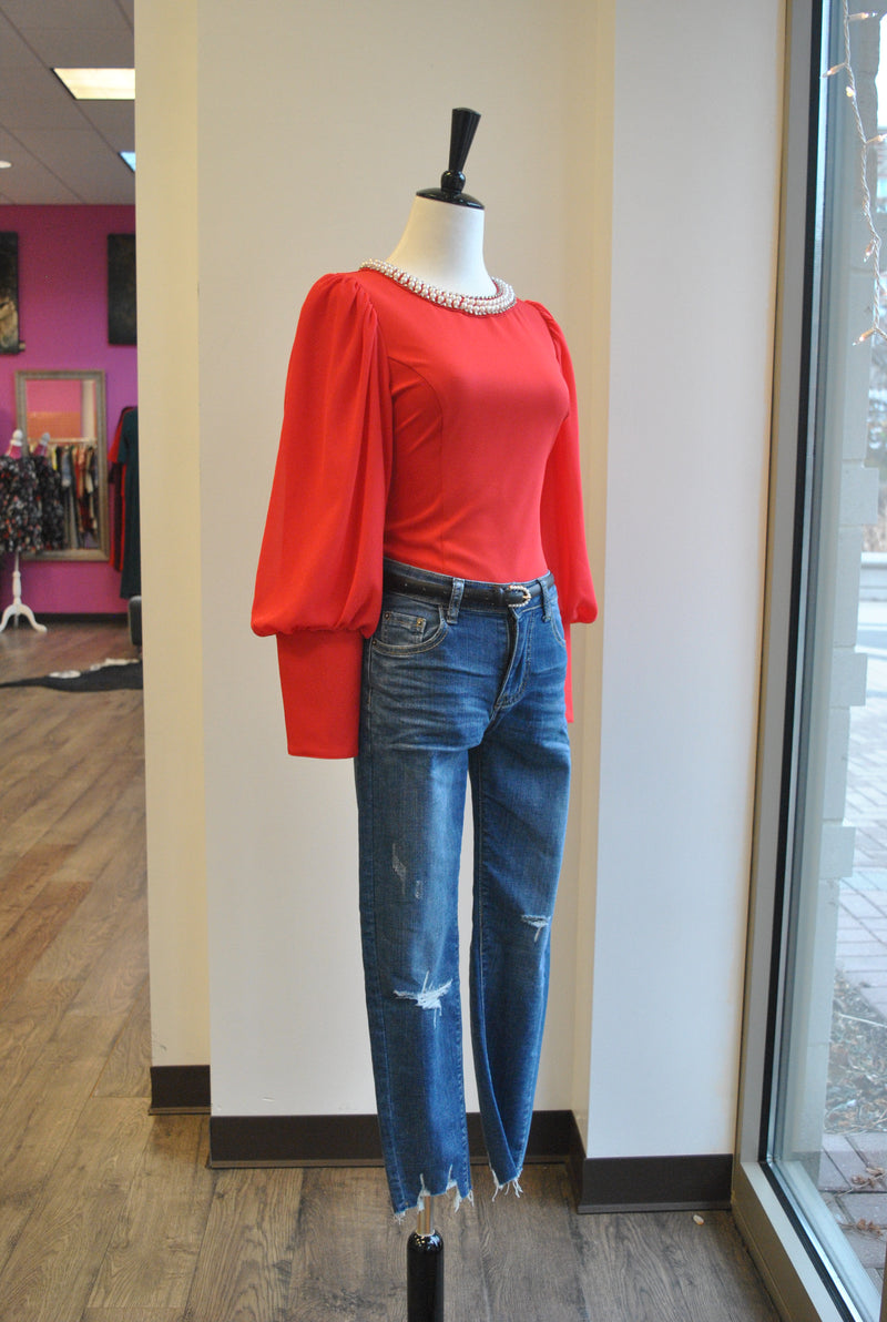 RED TOP WITH BELL SLEEVES AND PEARL NECK