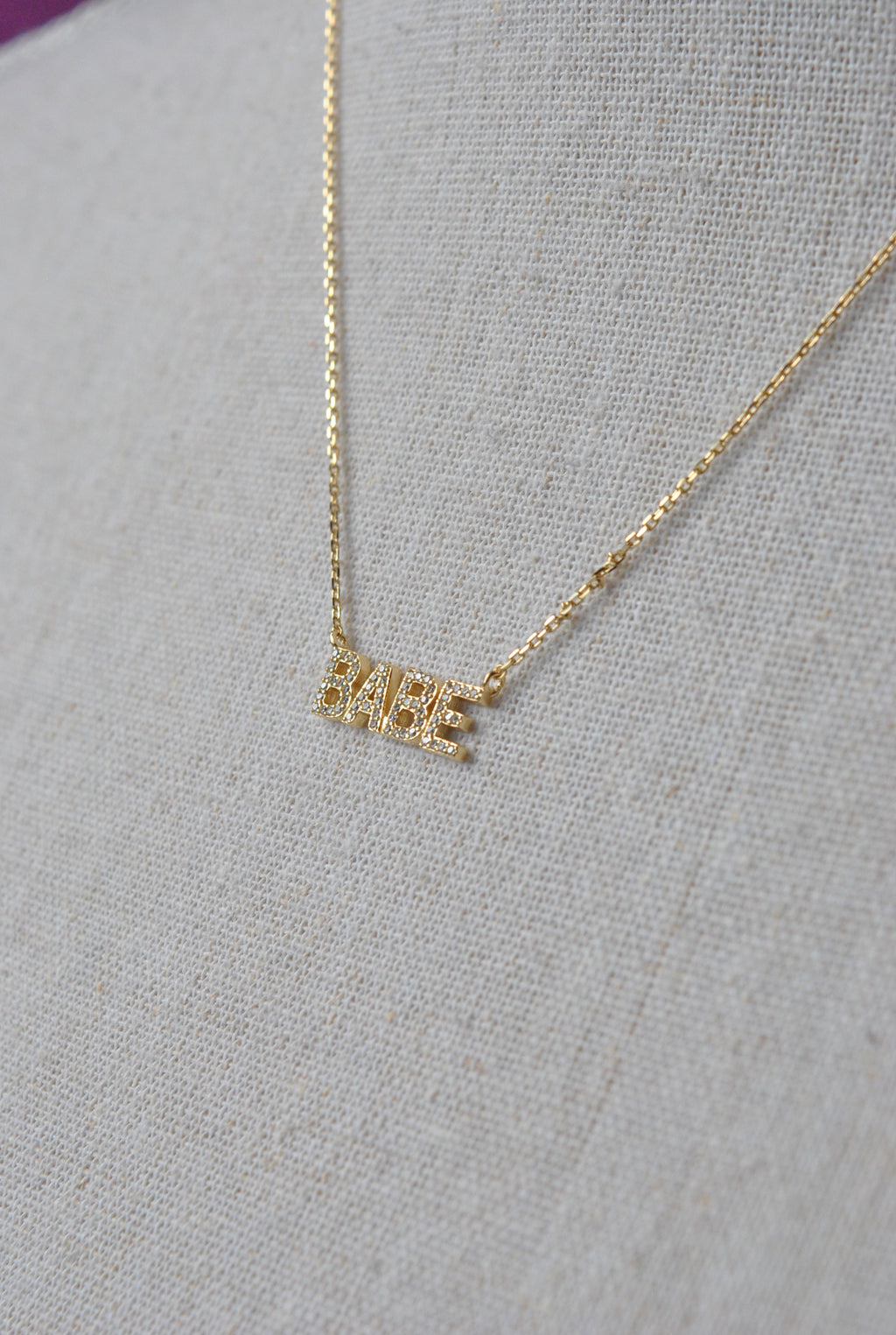 "GOLD NECKLACE WITH ""BABE"" PENDANT"