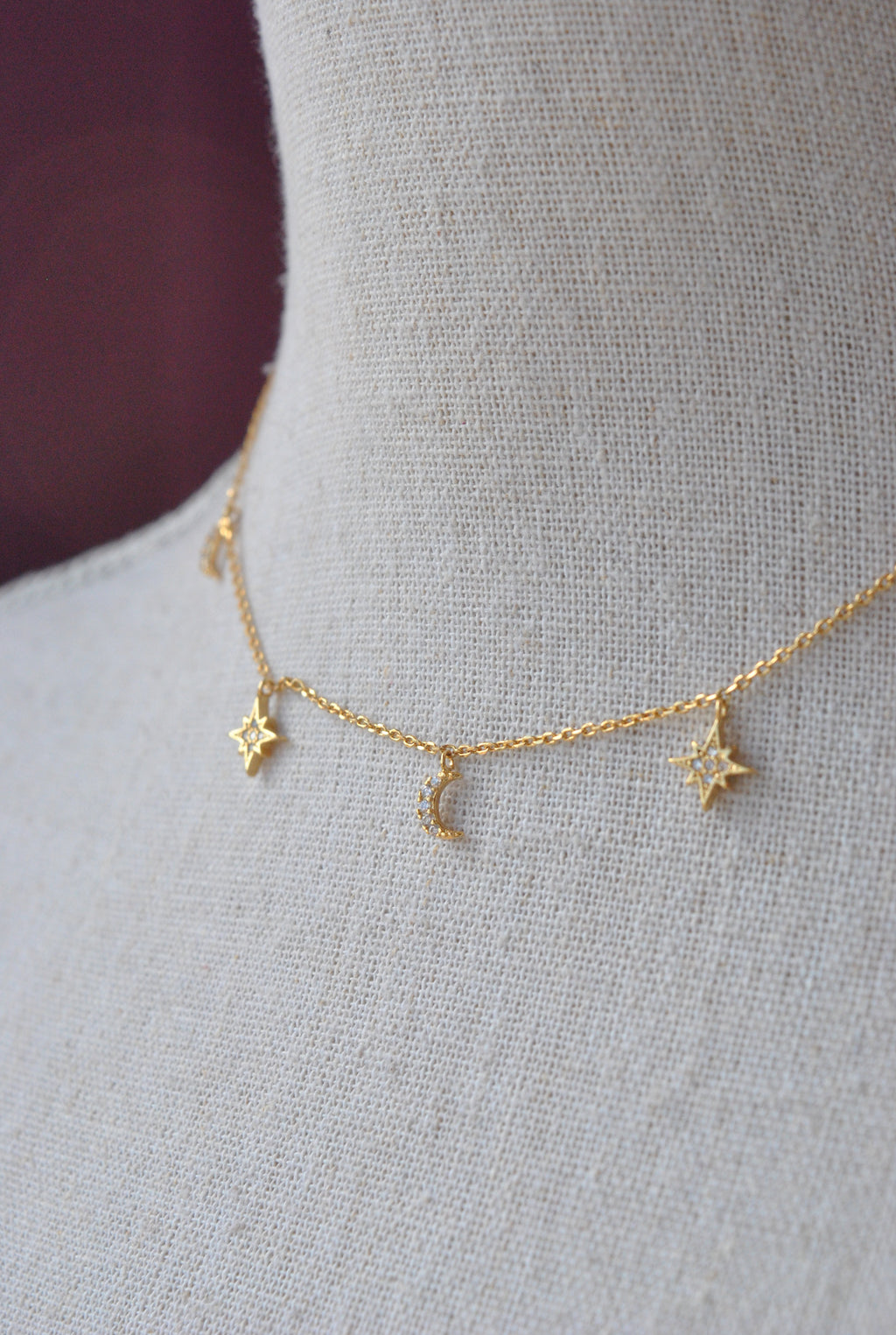 GOLD CHOKER STYLE NECKLACE WITH STAR CHARMS