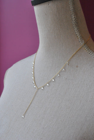 GOLD LONG NECKLACE WITH CRYSTALS CHARMS