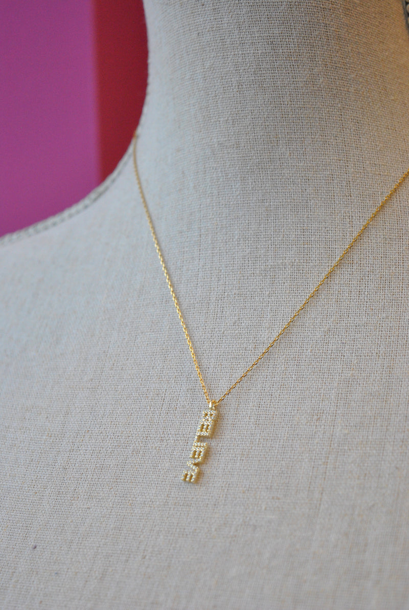 "GOLD DELICATE NECKLACE WITH ""BELIEVE' CHARM"