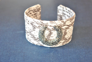 HITE AND TAUPE ECO LEATHER CUFF WITH CRYSTALS