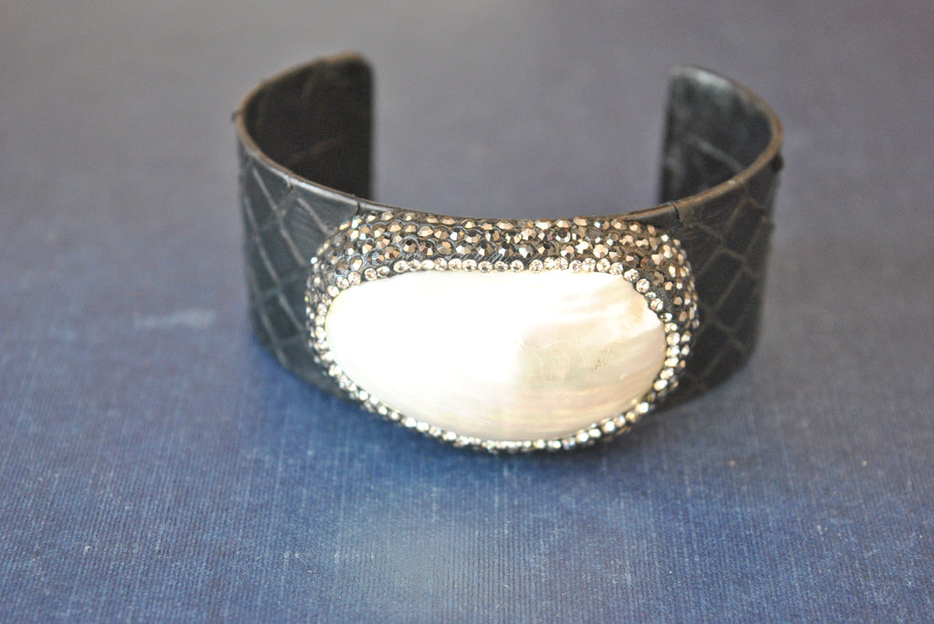 BLACK ECO LEATHER CUFF WITH WHITE SHELL AND SWAROVSKI CRYSTALS
