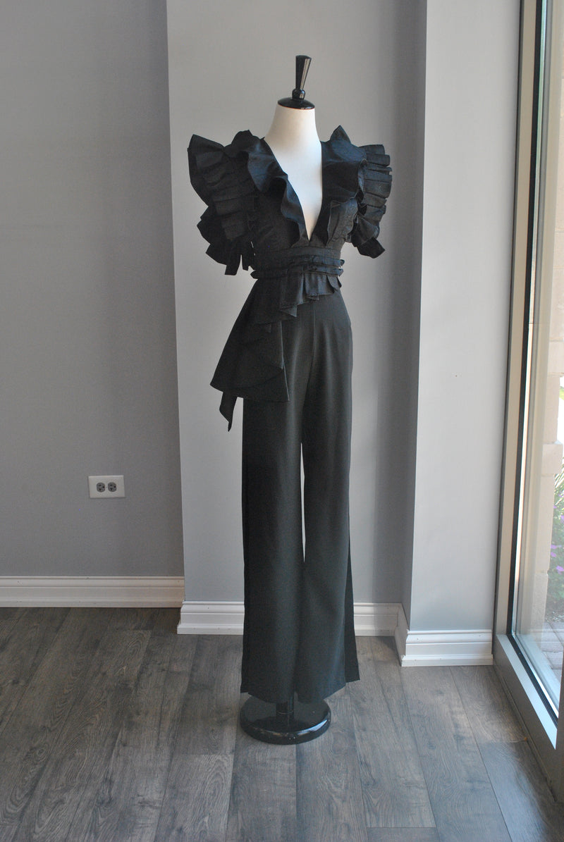BLACK JUMPSUIT WITH STATEMENT RUFFLE SLEEVES