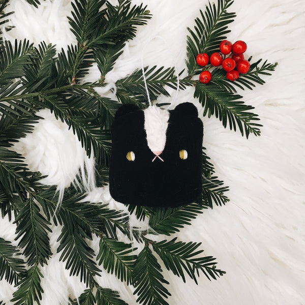 Black Winter Skunk Ornament - sleepy king