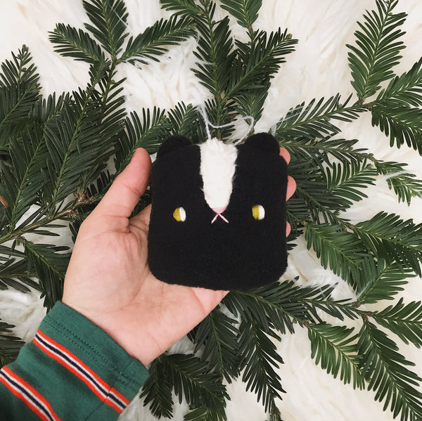 Black Winter Skunk Ornament