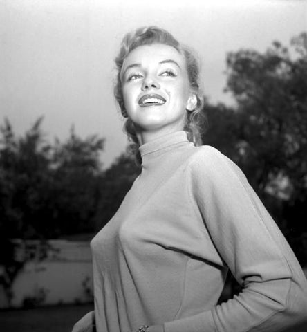 Marilyn Monroe sporting the once-stylish bullet bra under her sweater.