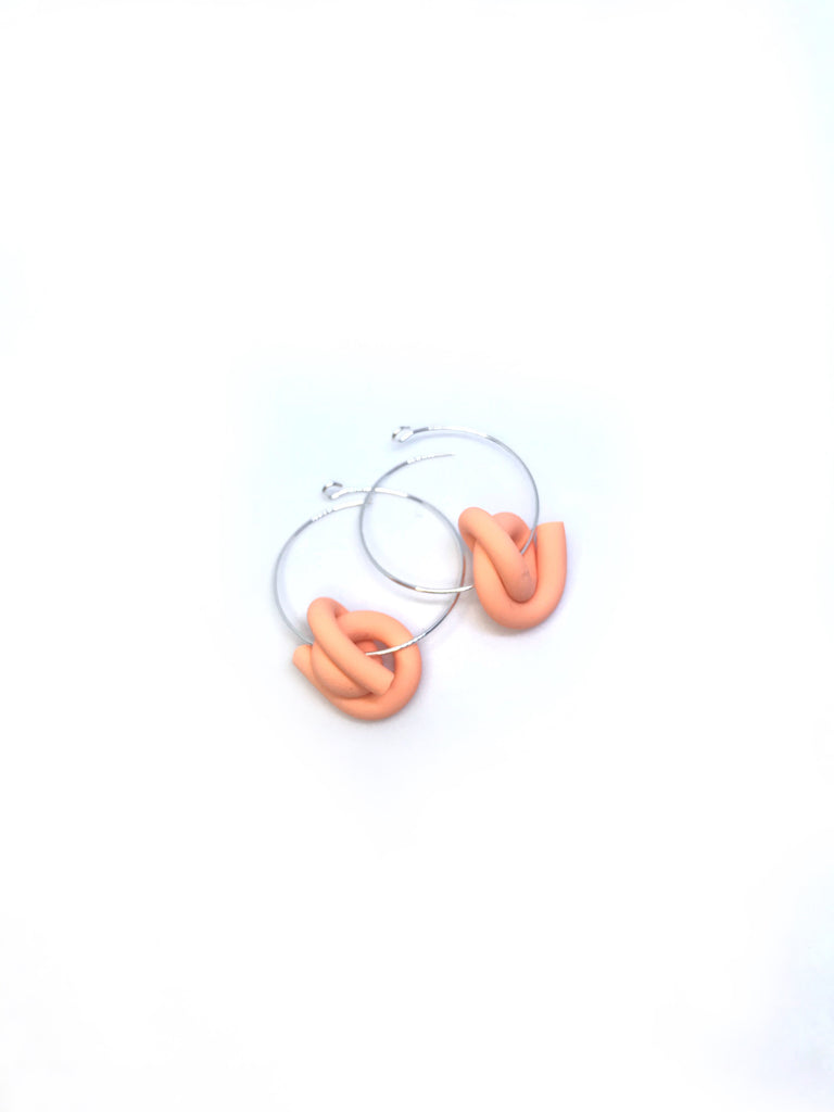 D. Orange Swirl Hoops