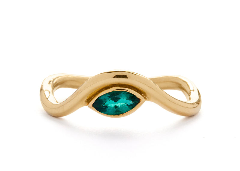 casual seance - curved yellow gold band with emerald marquise diamond