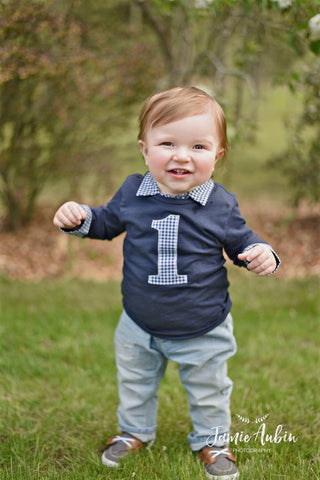 baby boy first birthday photo shoot navy shirt and jeans