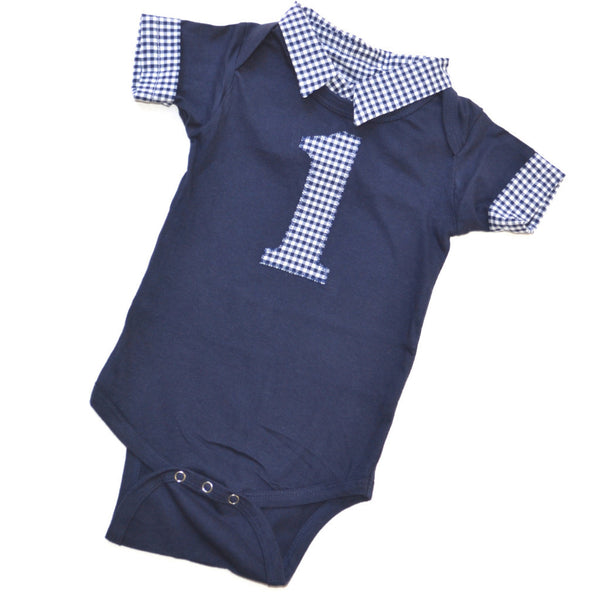 a navy onesie with matching 1 and collar and cuffs in gingham pattern