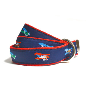 blue and red children's belt covered in colorful airplanes