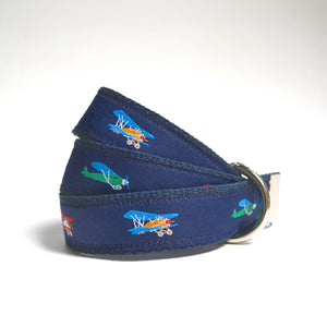 All navy blue belt covered in baby blue, orange and yellow airplanes for children