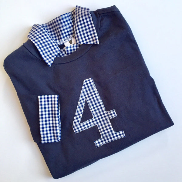 Number 4 on a blue shirt with matching navy gingham collar and cuffs for a fourth birthday