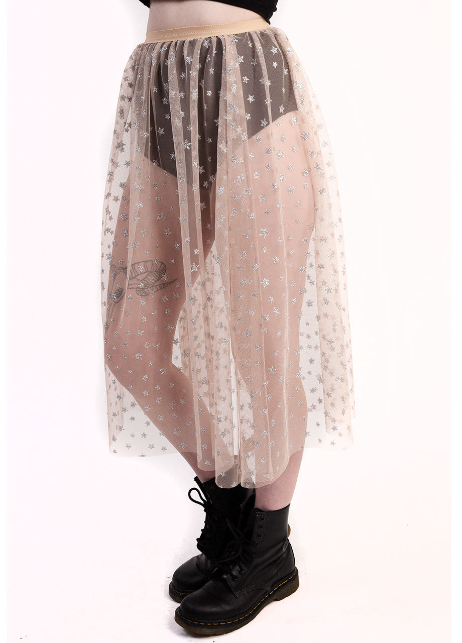 castles couture luna glitter skirt with star graphic print on sheer nude tulle material, worn over black velvet hot pants