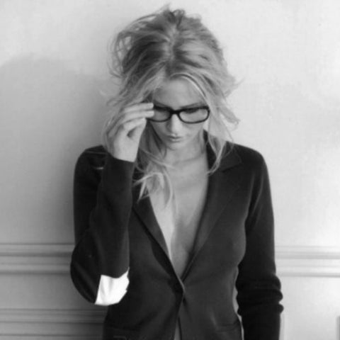 blonde with glasses wearing a black blouse