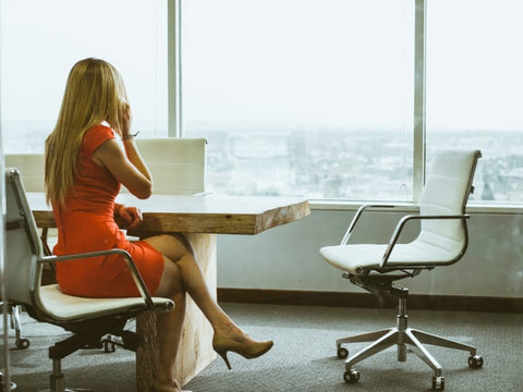 girl dressed in a red dress in the office