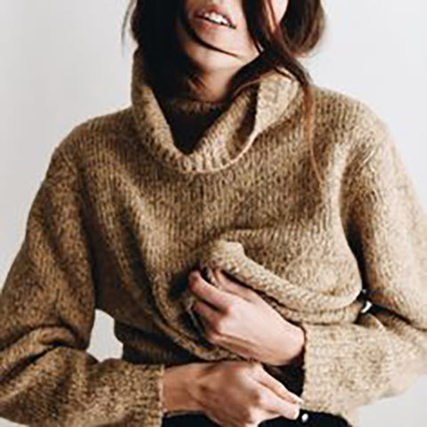 girl dressed in brown pullover