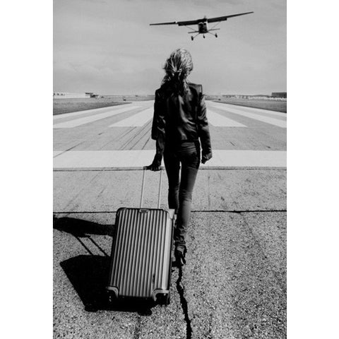 girl with a suitcase on the runway