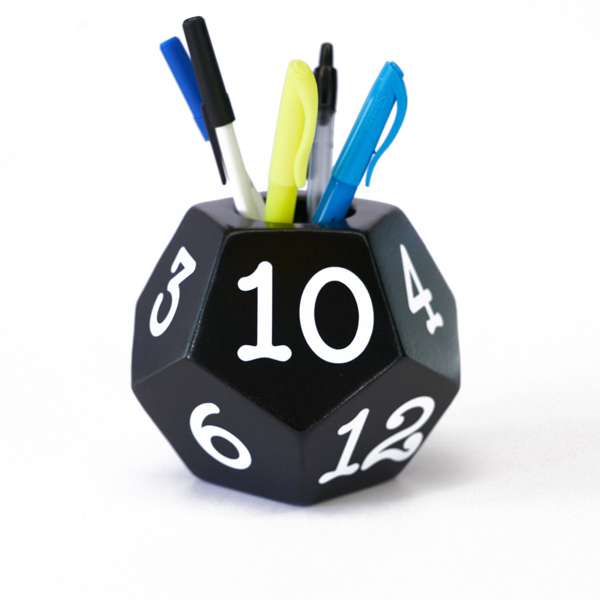 Geek novelty items designed to help you show off you geek side. Pictured is a 12 sided dice pencil holder in black with while letters created by Uniquely Geek a custom gaming table manufacturer