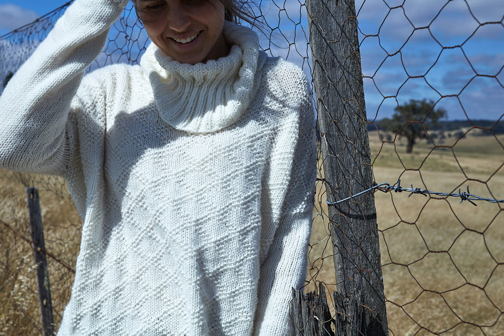 Wool days knitting pattern sweater girl by fence