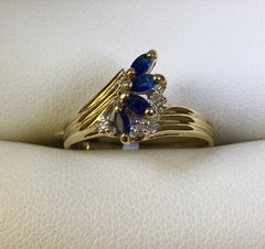9CT YELLOW GOLD SAPPHIRE AND DIAMOND TWIST DRESS RING