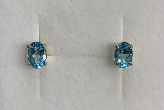 9Ct Yellow Gold 7X5Mm Blue Topaz Claw Set Stud Earrings