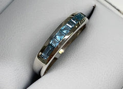 Sterling Silver Blue Topaz Channel Set Eternity Ring